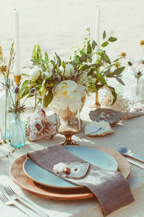 beach wedding place setting - photo by Hazelwood Photo http://ruffledblog.com/lincoln-city-beach-wedding-editorial