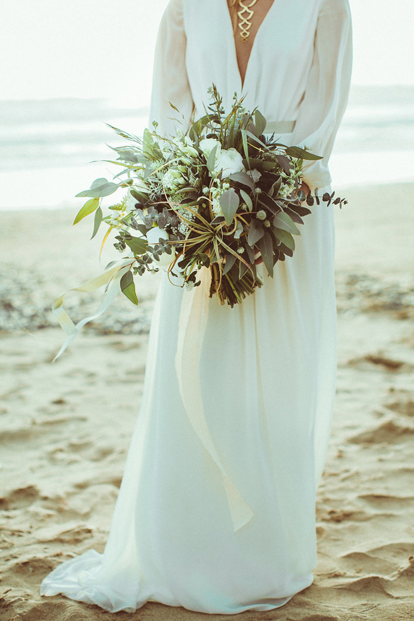 wild greenery bouquet - photo by Hazelwood Photo http://ruffledblog.com/lincoln-city-beach-wedding-editorial