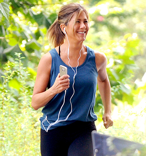 Jennifer Aniston rocks tight workout clothing on set of Mother's Day in Atlanta, Georgia.