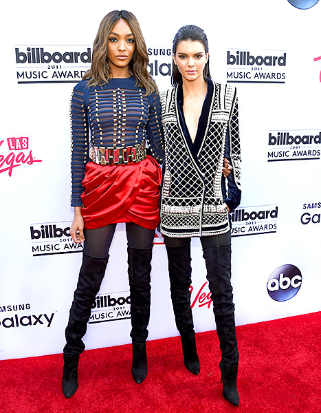 Jourdan Dunn and Kendall Jenner, both wearing Balmain x H&M, attend the 2015 Billboard Music Awards at MGM Grand Garden Arena on May 17, 2015 in Las Vegas, Nevada.