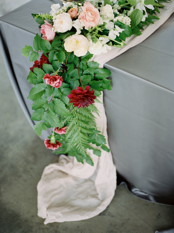 table runner with greenery and flowers - photo by Ashley Kelemen http://ruffledblog.com/organic-sophistication-in-venice-beach