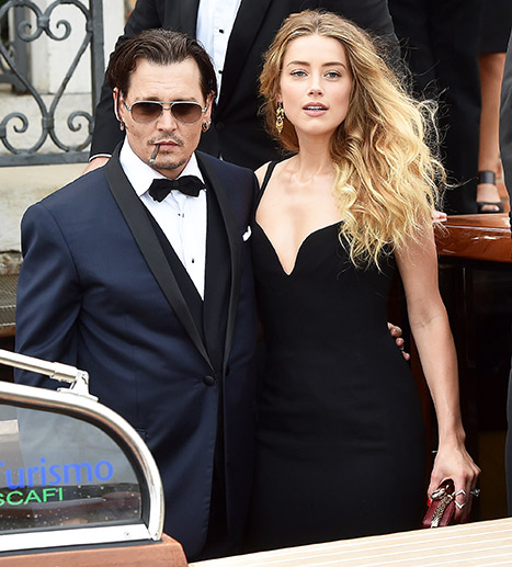 Johnny Depp and Amber Heard arrived at the Black Mass premiere in Venice via--what else?--a glam boat.