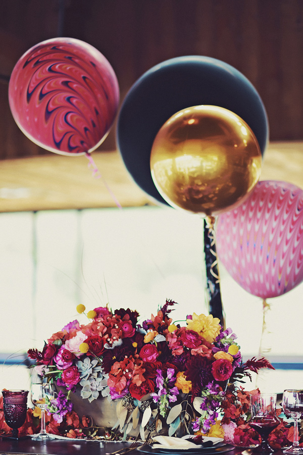wedding balloon centerpieces - photo by Tamiz Photography http://ruffledblog.com/inspired-by-color-wedding-ideas