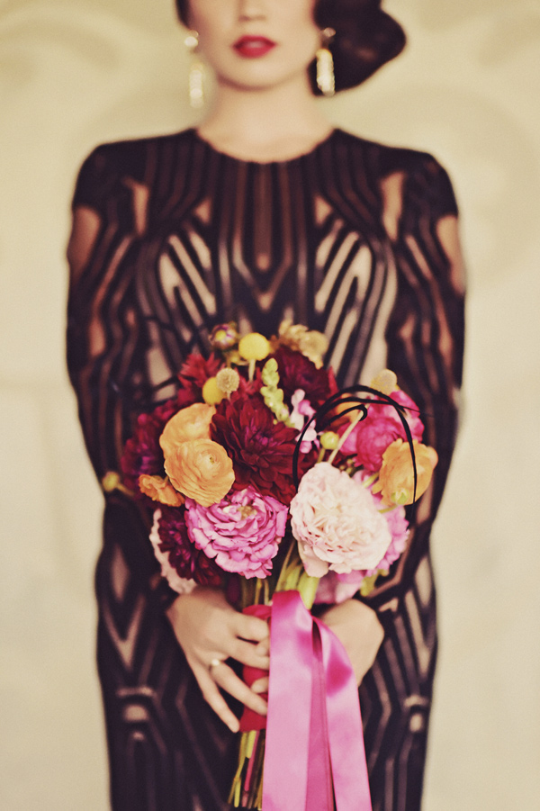 unique pink bouquet - photo by Tamiz Photography http://ruffledblog.com/inspired-by-color-wedding-ideas