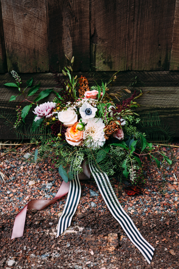 bouquet with striped ribbon - photo by Under the White Willow Photography http://ruffledblog.com/vintage-london-wedding-inspiration