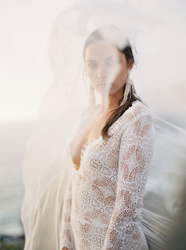 lace wedding dress - photo by Emily Fuselier Photography http://ruffledblog.com/cliffside-wedding-portraits-in-california