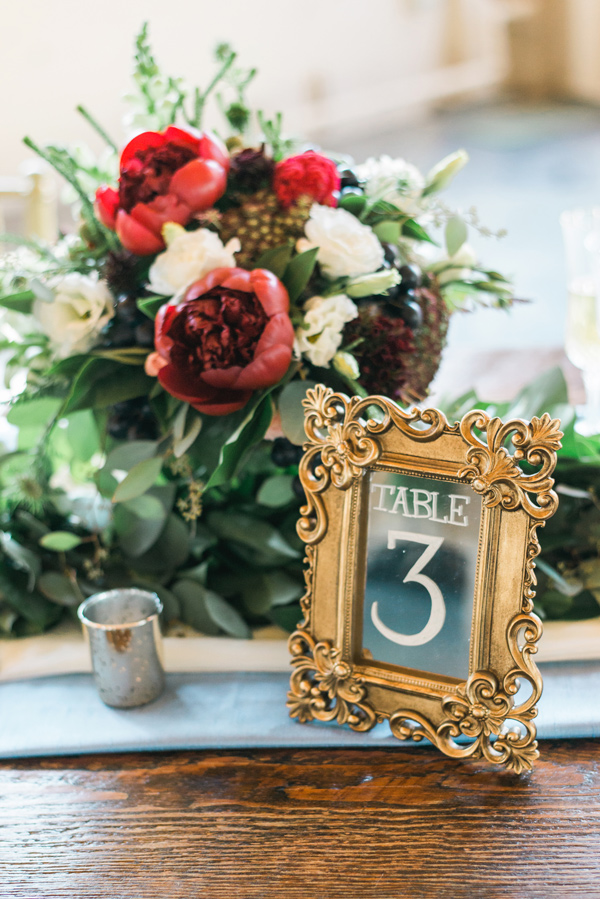 table number - photo by Lauryn Kay Photography http://ruffledblog.com/rich-hued-portland-wedding-inspiration