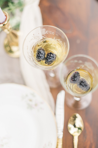 Champagne with berries | Joy Michelle Photography | see more on: http://burnettsboards.com/2015/10/windswept-wedding-inspiration/