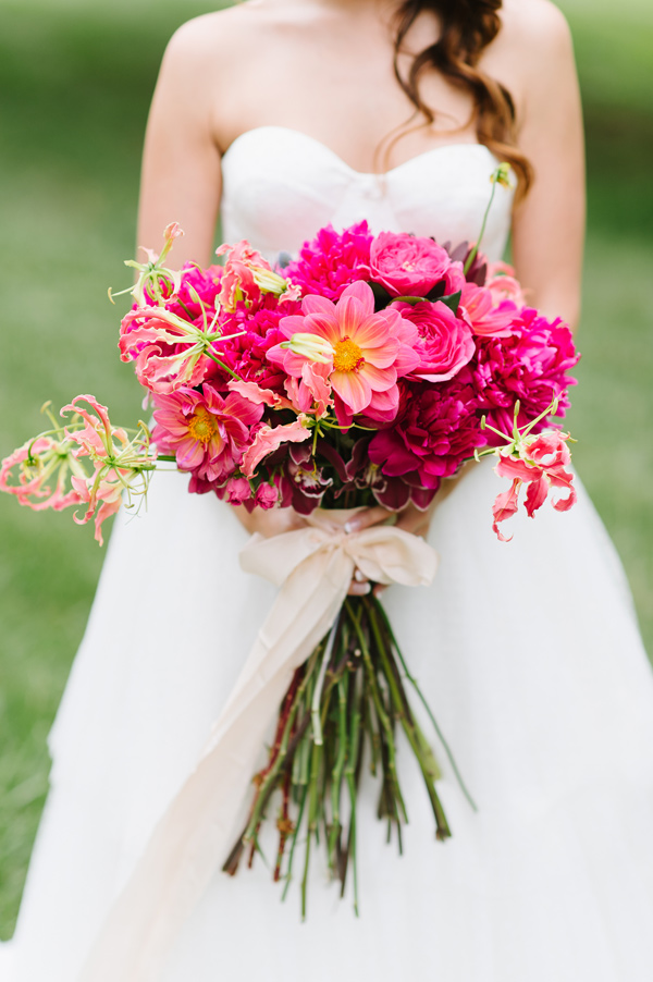 fuchsia bouquet - photo by Natalie Franke http://ruffledblog.com/vintage-hot-air-balloon-wedding