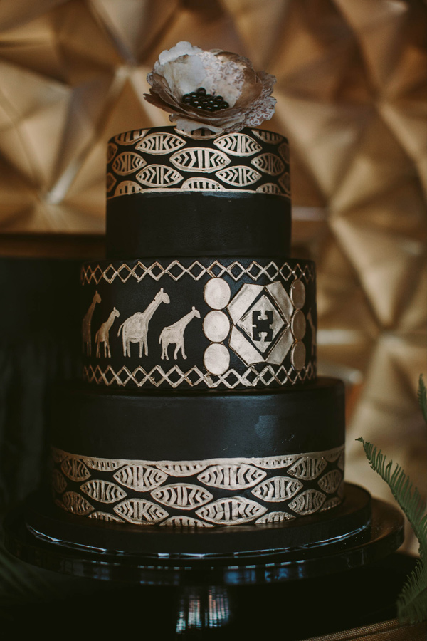 black and gold wedding cake - photo by Megan Saul Photography http://ruffledblog.com/modern-safari-wedding-inspiration
