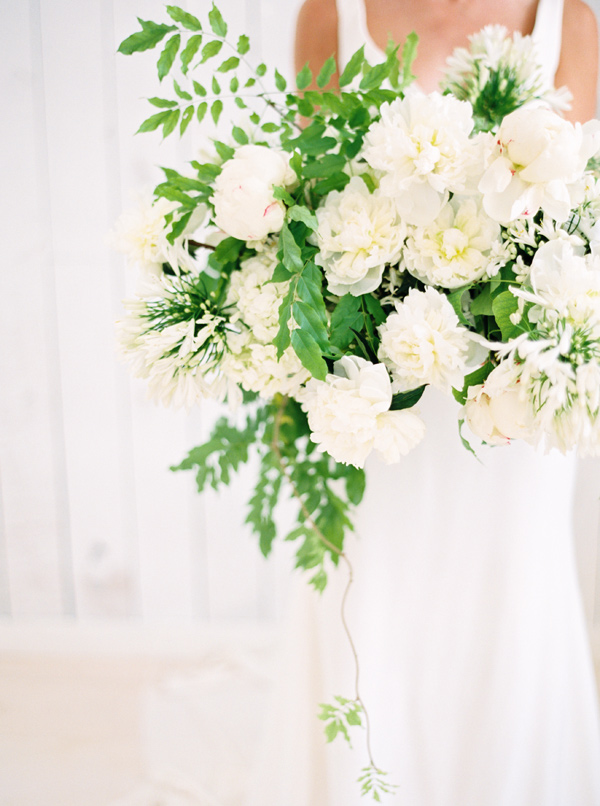 white bouquet with greenery - photo by Nicole Berrett Photography http://ruffledblog.com/hand-painted-wedding-inspiration