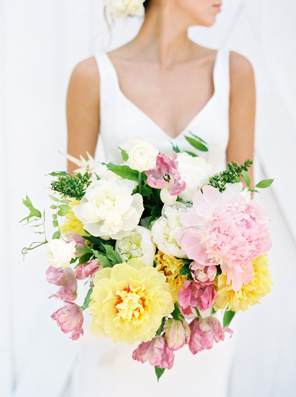 pink and yellow bouquet - photo by Nicole Berrett Photography http://ruffledblog.com/hand-painted-wedding-inspiration