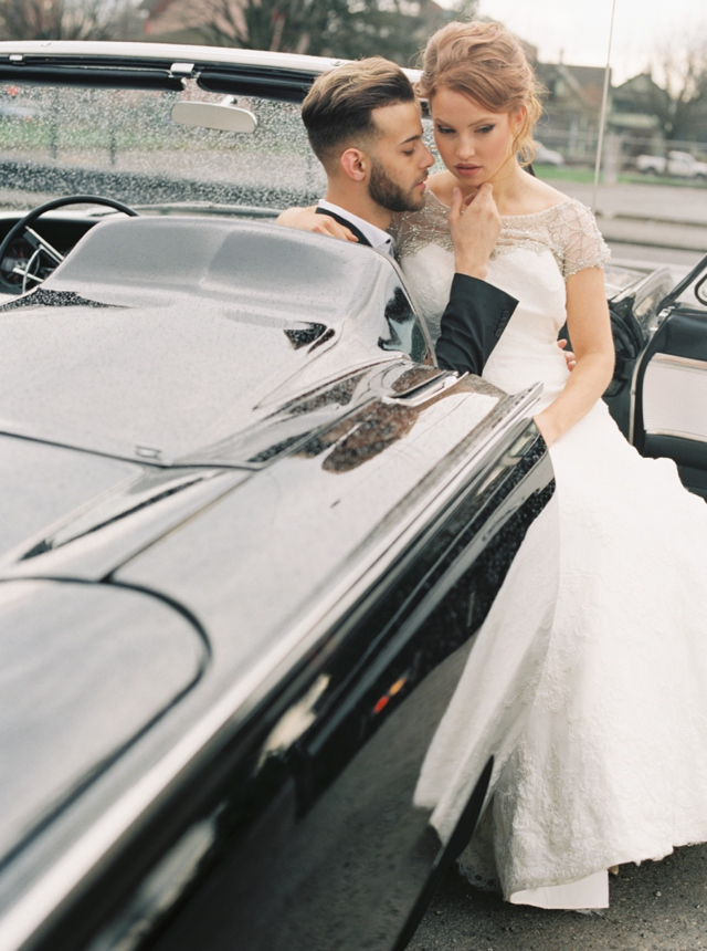 Vintage black getaway car | Christa Taylor Photography | see more on: http://burnettsboards.com/2015/11/urban-industrial-rooftop-wedding/