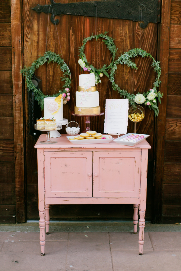 wedding cake table - photo by Milou and Olin http://ruffledblog.com/romantic-blush-winery-wedding