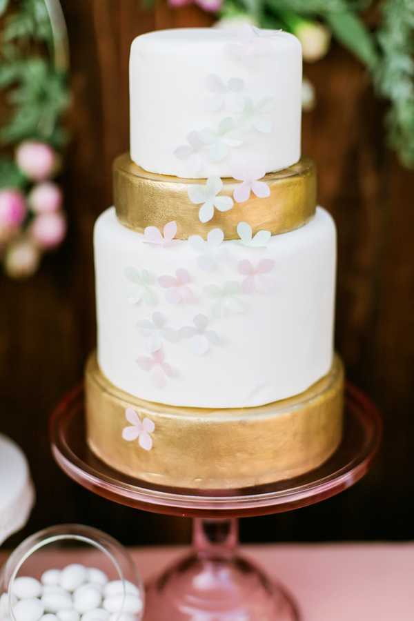 wedding cake with iridescent flowers - photo by Milou and Olin http://ruffledblog.com/romantic-blush-winery-wedding