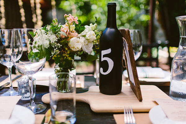 wine bottle table number - photo by Redfield Photography http://ruffledblog.com/nyc-brunch-garden-wedding
