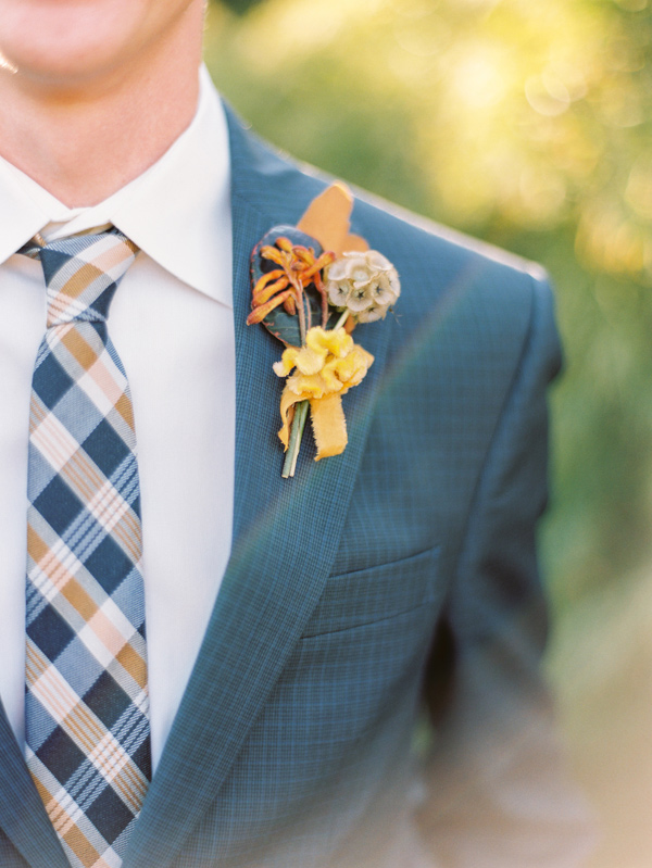 mustard boutonniere - photo by Love by Serena http://ruffledblog.com/copper-and-slate-autumn-inspiration-shoot