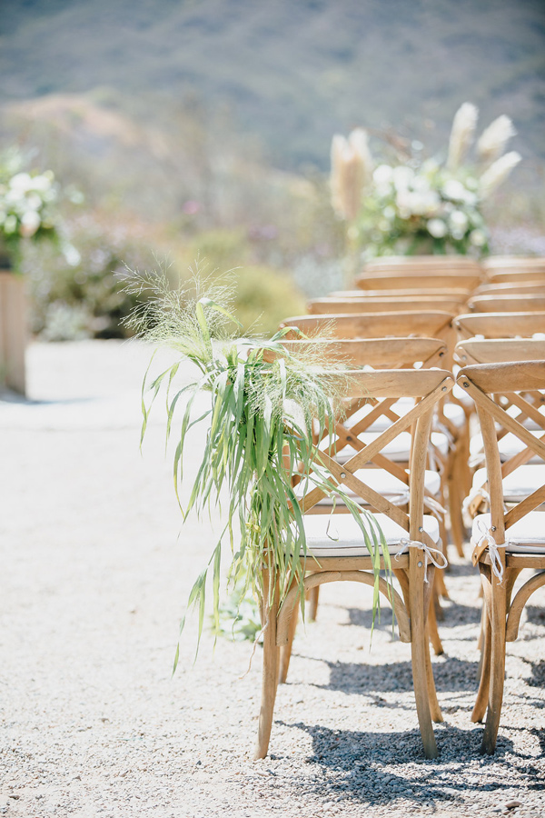 ceremony chair and decor - photo by Marble Rye Photography http://ruffledblog.com/desert-dance-party-wedding-in-ojai