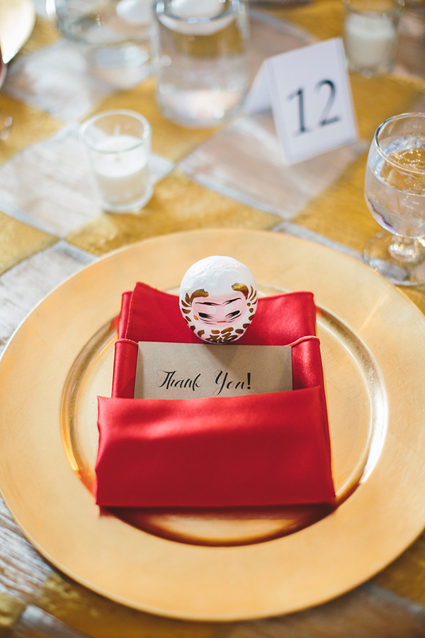 red and gold place setting - photo by Readyluck Studios http://ruffledblog.com/industrial-wedding-at-a-metalworking-studio