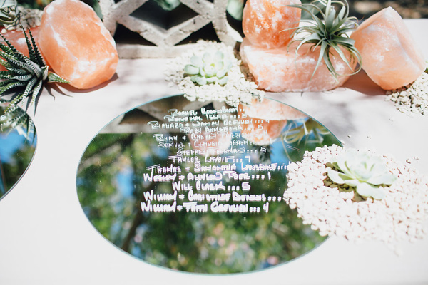 mirrored seating chart - photo by Marble Rye Photography http://ruffledblog.com/desert-dance-party-wedding-in-ojai