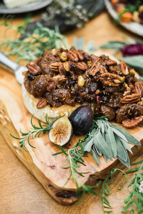 brie with figs and pecans - photo by Tara Bielecki Photography http://ruffledblog.com/fall-harvest-friendsgiving-wedding