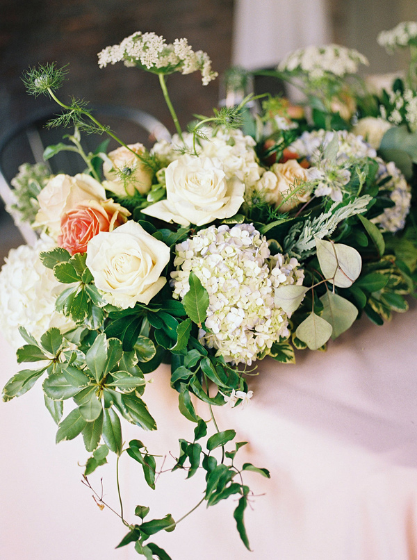 hydrangea and rose centerpiece - photo by Tracy Enoch Photography http://ruffledblog.com/organic-bohemian-wedding-inspiration