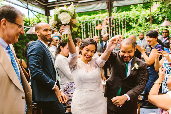 ceremony recessional - photo by Redfield Photography http://ruffledblog.com/nyc-brunch-garden-wedding