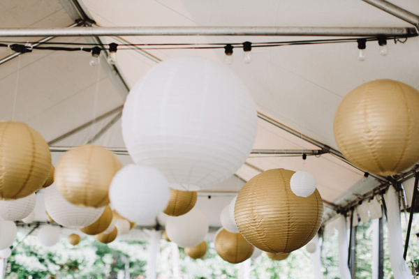 gold paper lanterns - photo by With Love and Embers http://ruffledblog.com/valley-crest-farm-wedding