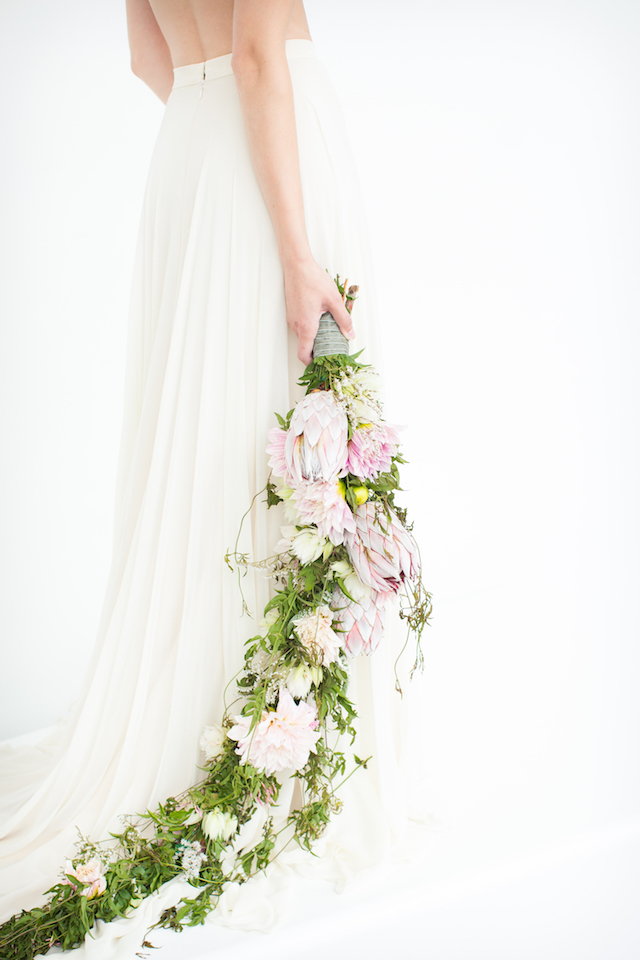 Cascading protea bridal bouquet | Canary Grey and a&bé bridal boutique | see more on: http://burnettsboards.com/2015/11/incredible-wedding-dresses/