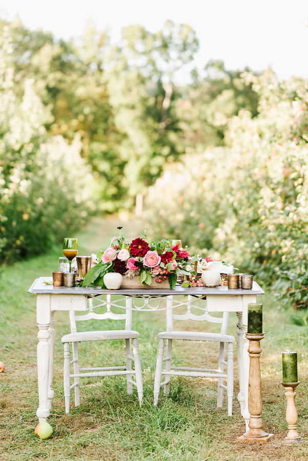 apple orchard wedding table - photo by Annmarie Swift Photography http://ruffledblog.com/autumn-orchard-romance-inspiration-shoot
