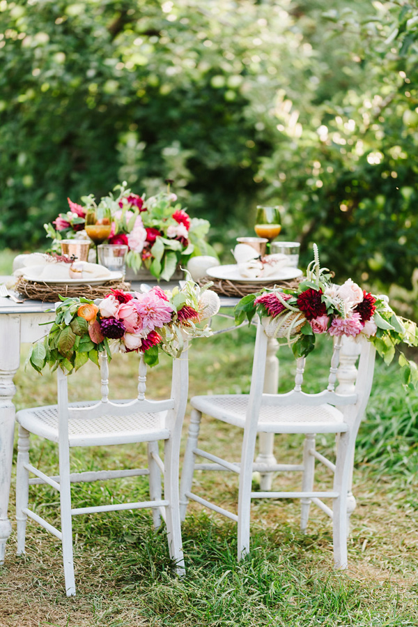 floral chair backs - photo by Annmarie Swift Photography http://ruffledblog.com/autumn-orchard-romance-inspiration-shoot