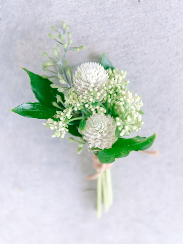 green and white boutonniere - photo by Pasha Belman Photography http://ruffledblog.com/bohemian-styled-southern-wedding-inspiration