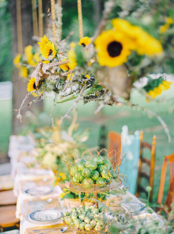 sunflower decor - photo by Pasha Belman Photography http://ruffledblog.com/bohemian-styled-southern-wedding-inspiration