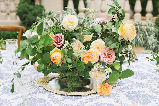 Peach and green floral centerpiece | Ivy & Stone Photography | see more on: http://burnettsboards.com/2015/11/world-european-romance-themed-wedding/