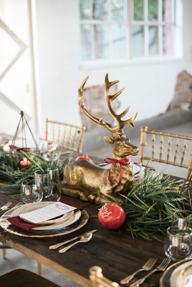 Golden reindeer centerpiece | Stephanie Ramsey and Melissa Malouf | see more on: http://burnettsboards.com/2015/12/christmas-wedding-ideas/