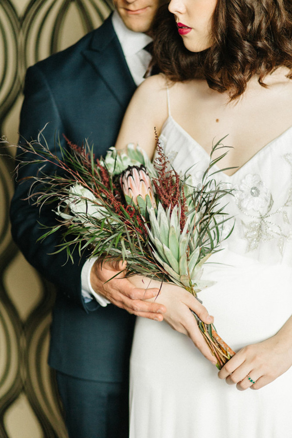 protea bouquet - photo by Emily Sacco http://ruffledblog.com/glam-holiday-wedding-inspiration
