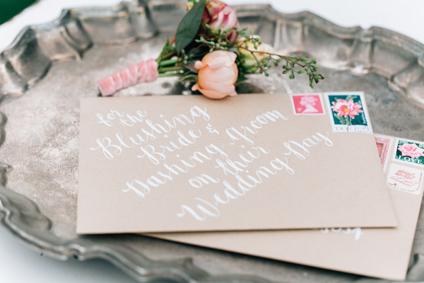 kraft paper calligraphy - photo by Lora Grady Photography http://ruffledblog.com/fairytale-cottage-wedding-at-craven-farm