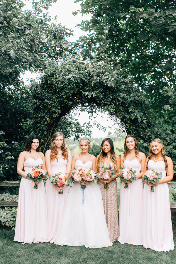 bridesmaids in blush pink - photo by Lora Grady Photography http://ruffledblog.com/fairytale-cottage-wedding-at-craven-farm