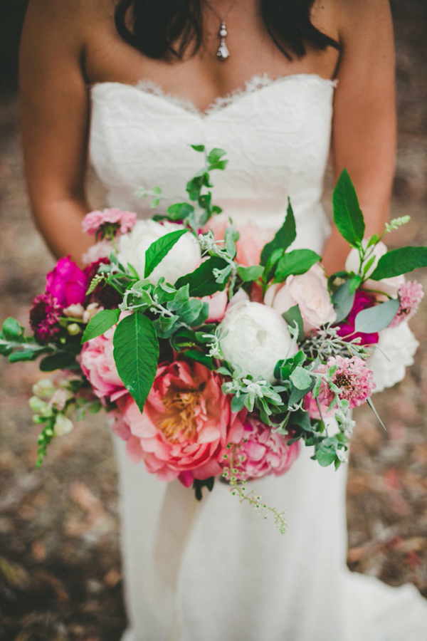 pink bouquet with greenery - photo by Melissa Biador http://ruffledblog.com/mixed-metals-wedding-in-la-jolla