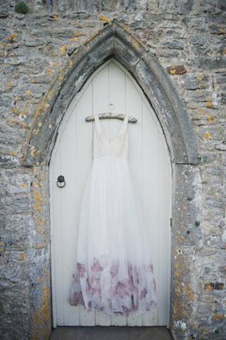 Wedding dress with lavender detail | Laura Power Photography and @thewedbazaar | see more on: http://burnettsboards.com/2015/12/gem-themed-wedding-castle/