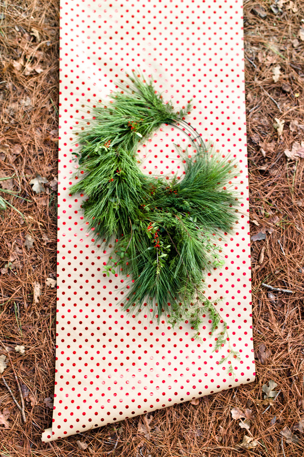 cascading wreath DIY - photo by Twin Lens Weddings http://ruffledblog.com/diy-cascading-holiday-wreath