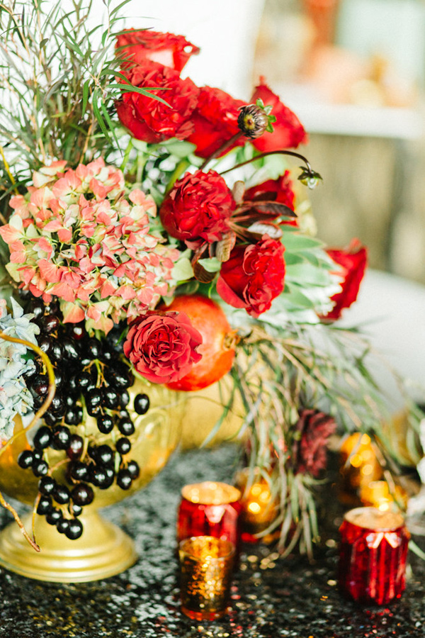 red holiday centerpiece - photo by Emily Sacco http://ruffledblog.com/glam-holiday-wedding-inspiration