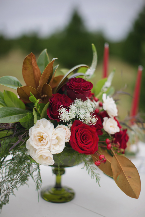 red centerpiece - photo by Janeane Marie Photography http://ruffledblog.com/christmas-tree-farm-inspiration-shoot