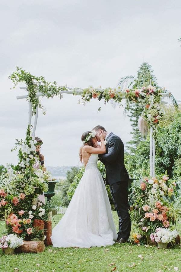 floral ceremony arch - photo by I Love Wednesdays http://ruffledblog.com/best-of-2015-wedding-ceremonies