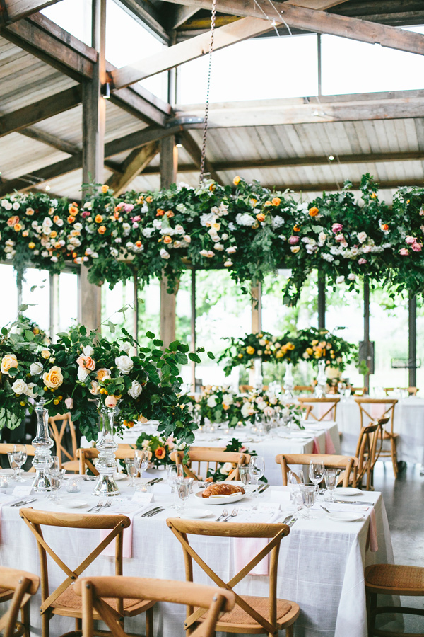 wedding reception filled with flowers - photo by Love Katie and Sarah http://ruffledblog.com/best-of-2015-wedding-reception
