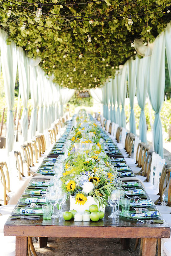 cool toned vineyard reception table - photo by Gideon Photography http://ruffledblog.com/best-of-2015-wedding-receptions