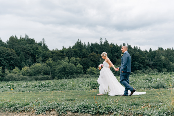 newlyweds - photo by Lora Grady Photography http://ruffledblog.com/fairytale-cottage-wedding-at-craven-farm