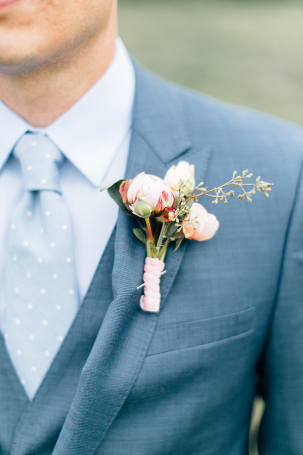 pale peach boutonniere - photo by Lora Grady Photography http://ruffledblog.com/fairytale-cottage-wedding-at-craven-farm