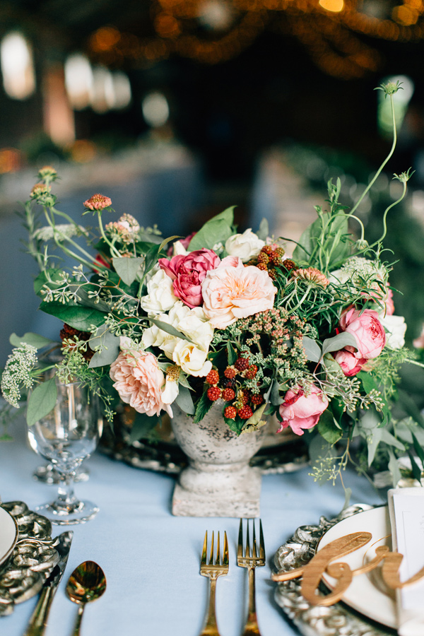 garden inspired centerpiece - photo by Lora Grady Photography http://ruffledblog.com/fairytale-cottage-wedding-at-craven-farm
