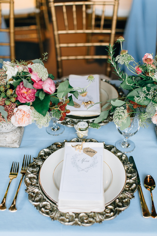 metallic place setting - photo by Lora Grady Photography http://ruffledblog.com/fairytale-cottage-wedding-at-craven-farm